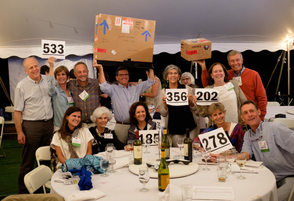Happy bidders at the end of a successful Friday evening. Thanks to all for their generous support!