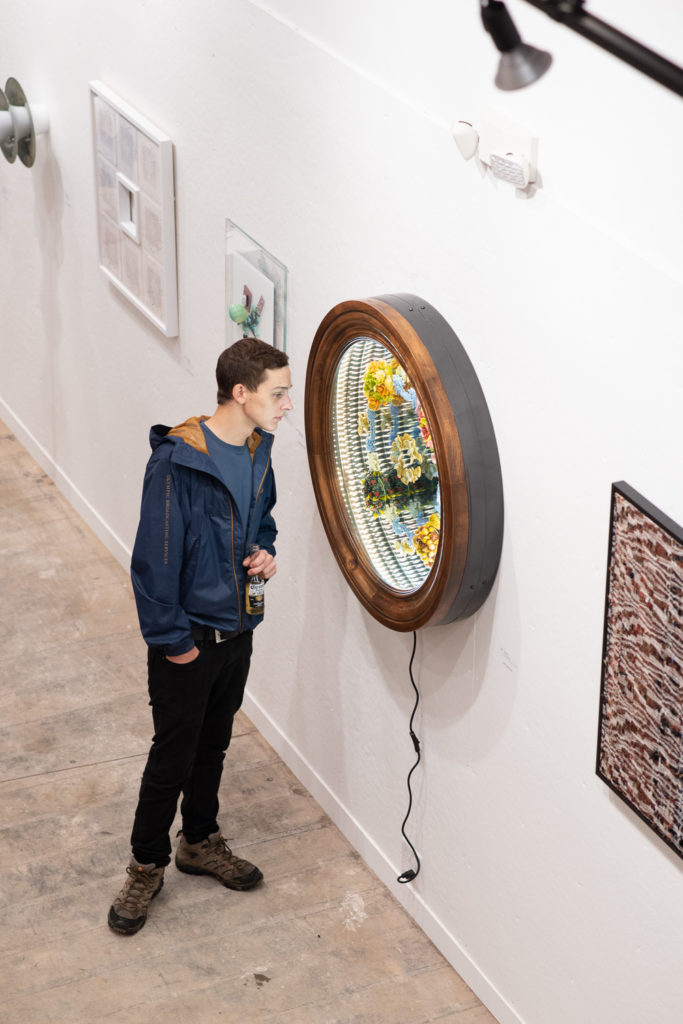 """Admiring this year's featured piece, """"8 Bats 4 Seasons"""" by Tim Tate."""