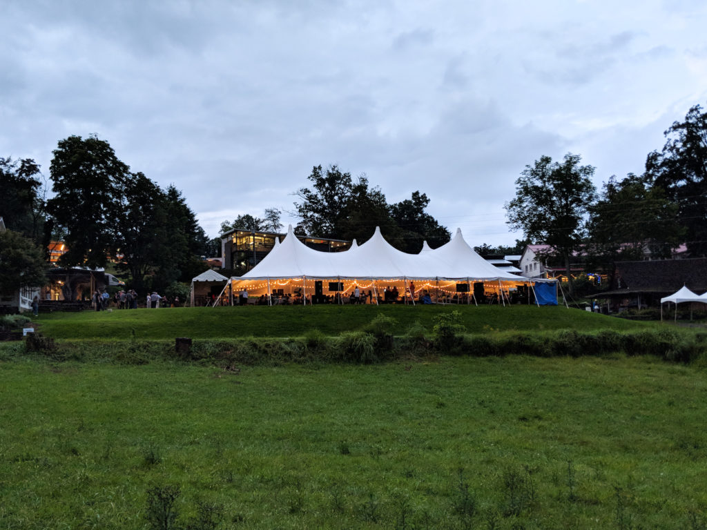 Meanwhile, as the evening got darker, the tent lit up for Friday's live auction.