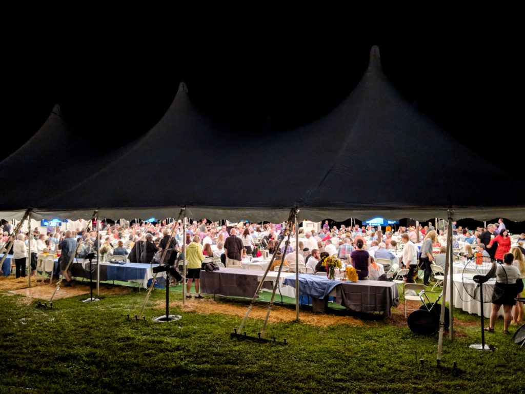 The action under the tent by night.