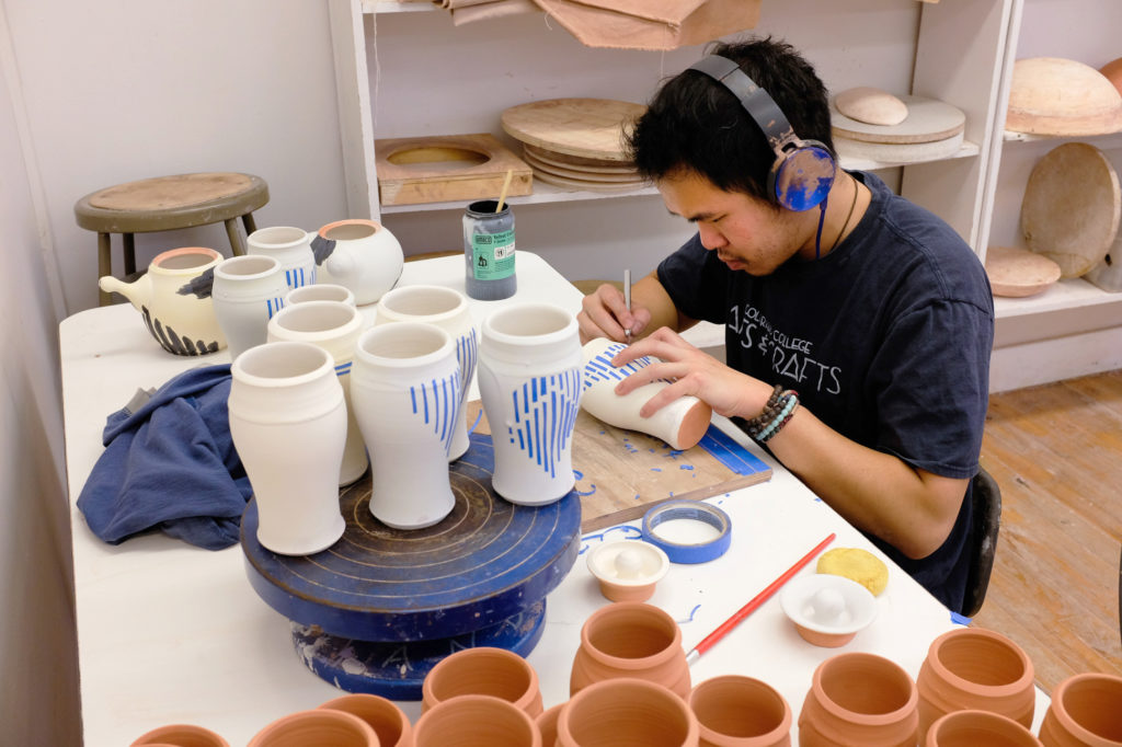 adding surface decoration to a run of bisqued pots