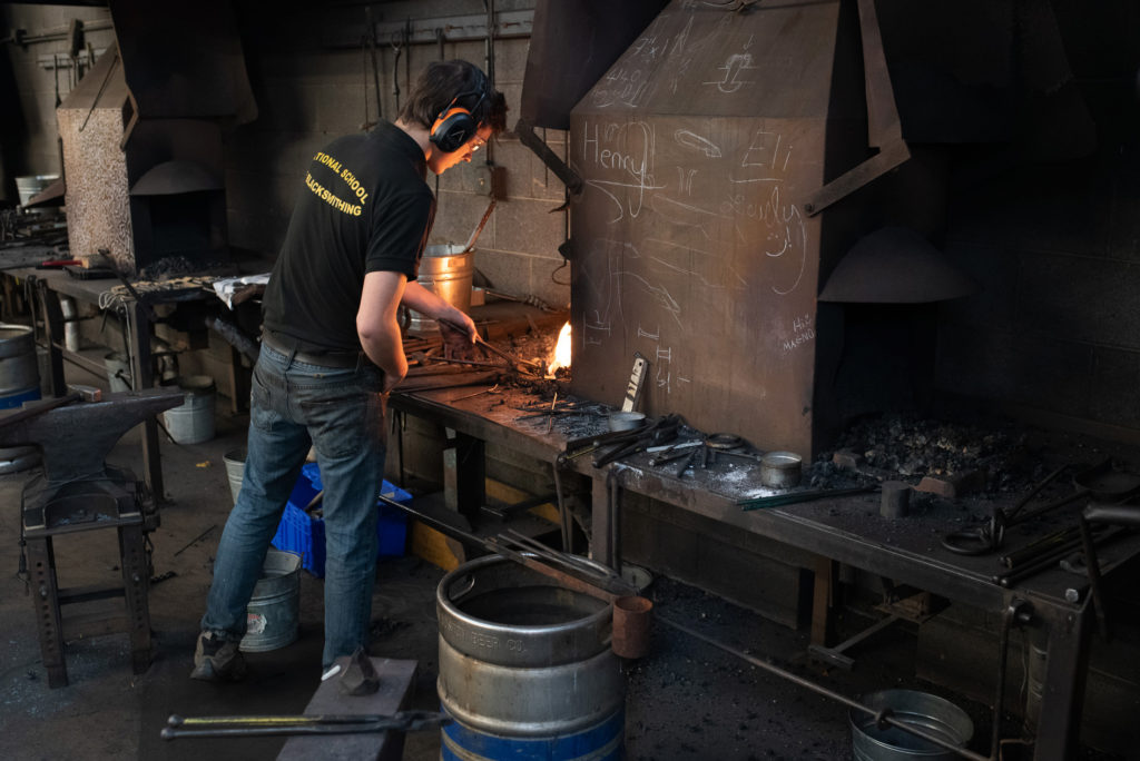 heating at the forge in the iron studio
