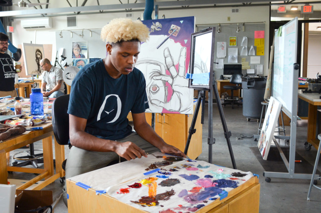 Tyrik at work on a self-portrait in the Penland Painting Studio