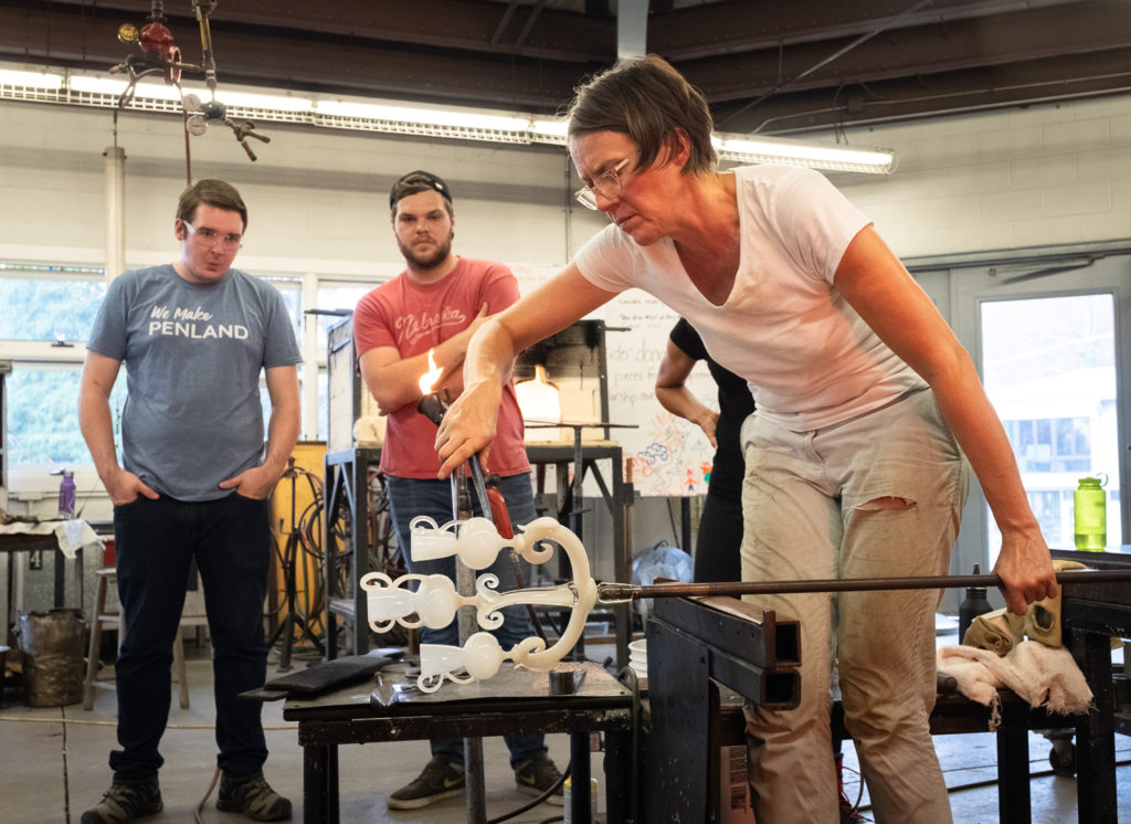 Glassblower Katherine Gray demonstrating in the Penland glass shop.