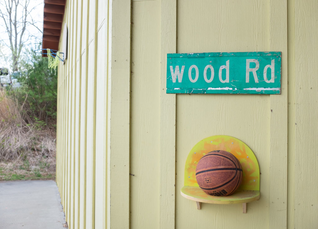 A basketball on a shelf at the wood studio.