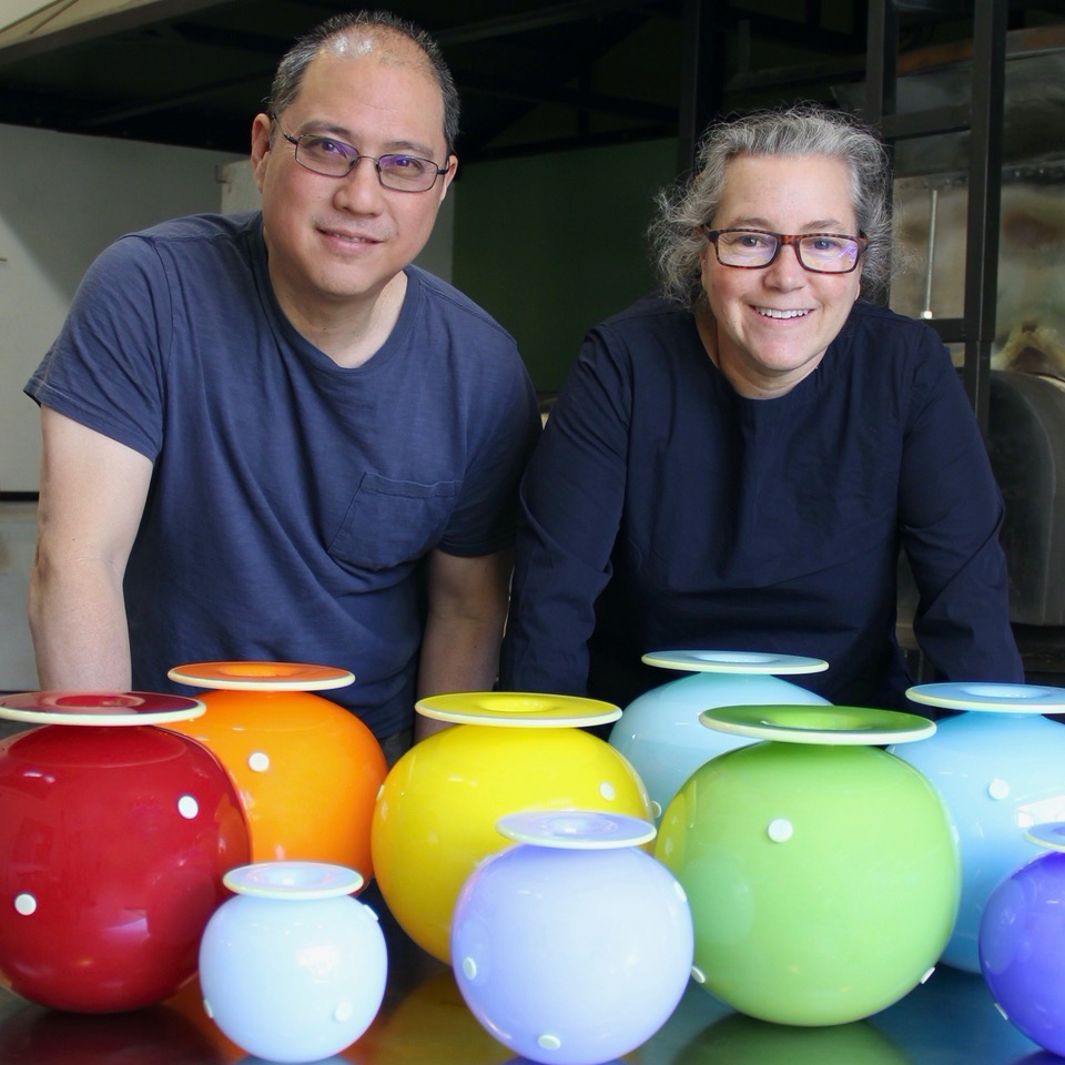 Boyd Sugiki and Lisa Zerkowitz with a rainbow of their vessels