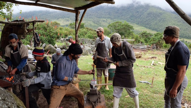 blacksmiths working at an outdoor anvil in Venezuela