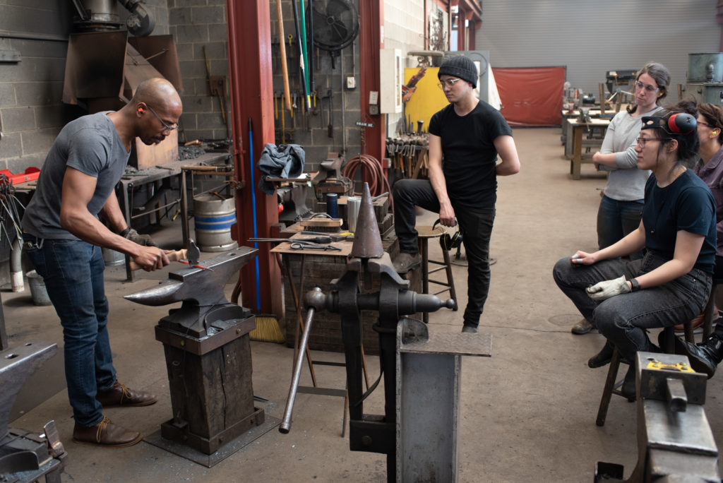 Penland instructor David Clemons demonstrating at the anvil