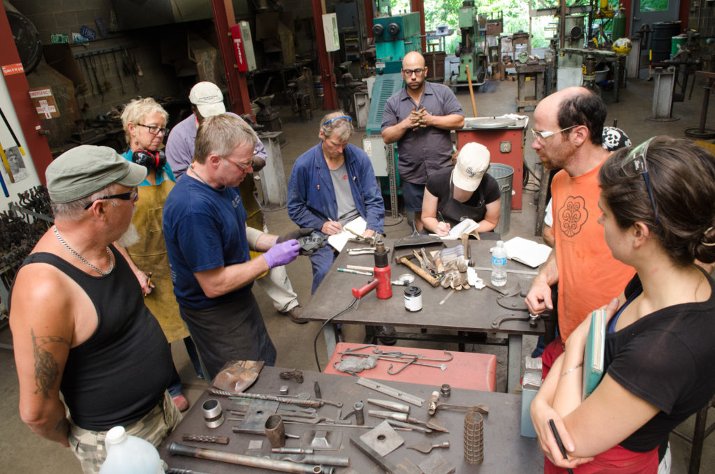 Stephen Yusko teaching in Penland iron studio