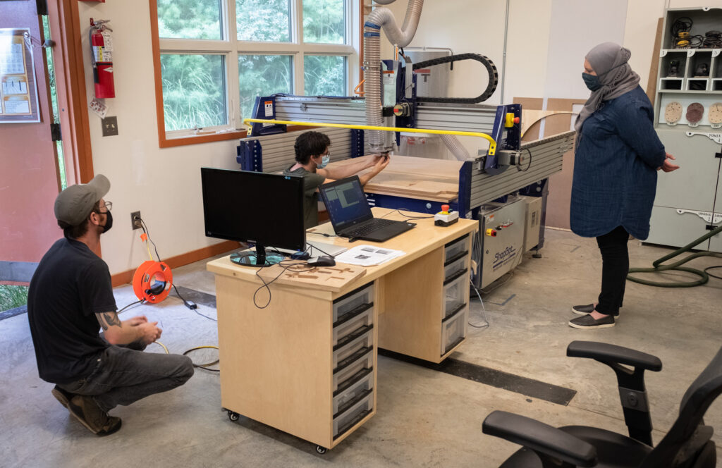jack mauch demonstrating the use of the CNC router in the Penland wood studio