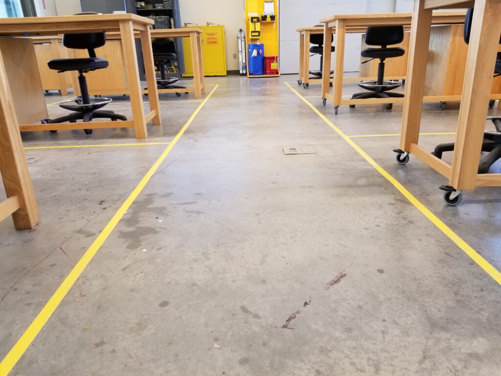 floor tape marking each student's work space in the Penland drawing and painting studio