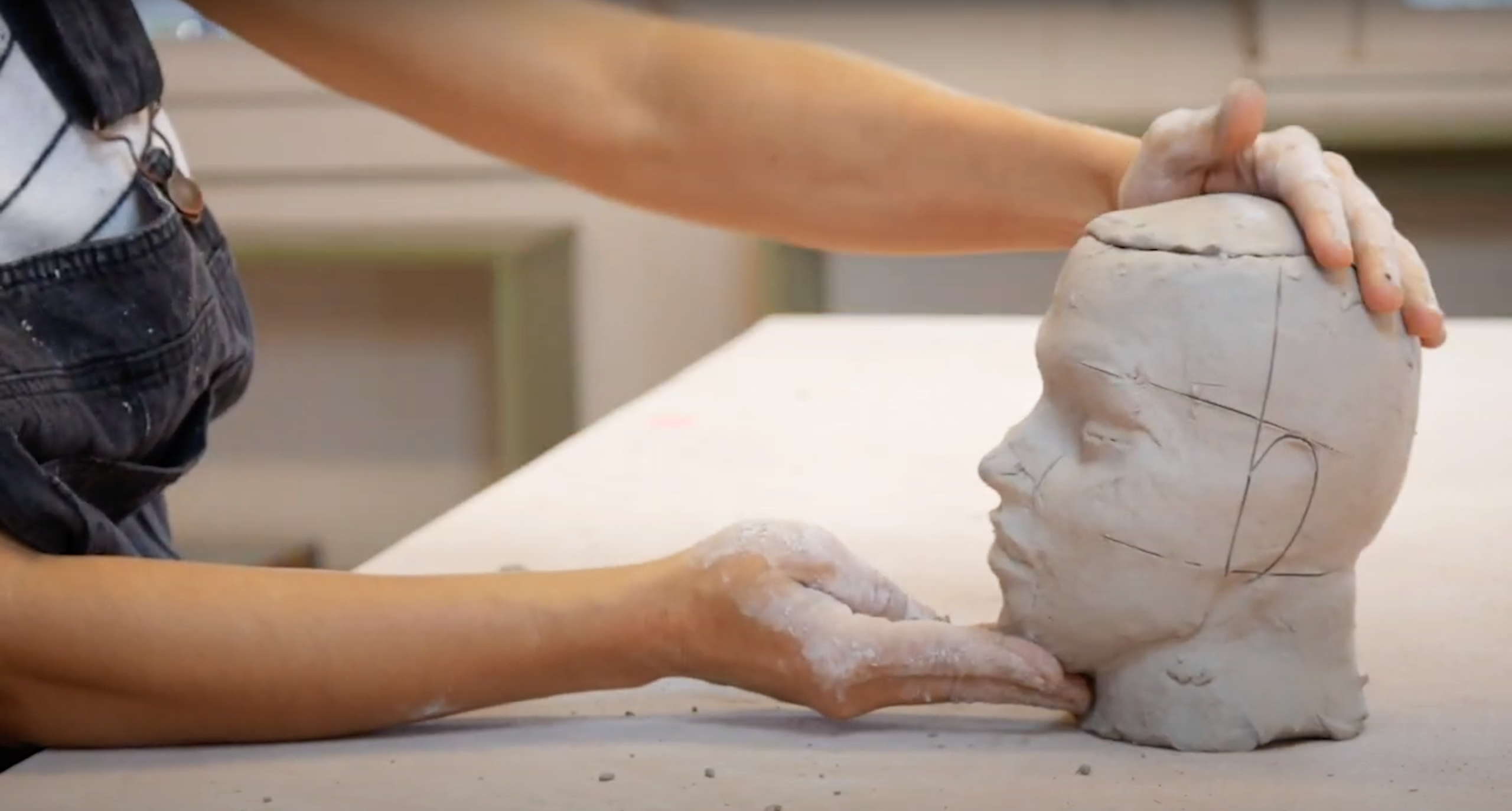Cristina refining the features of her sculpted head