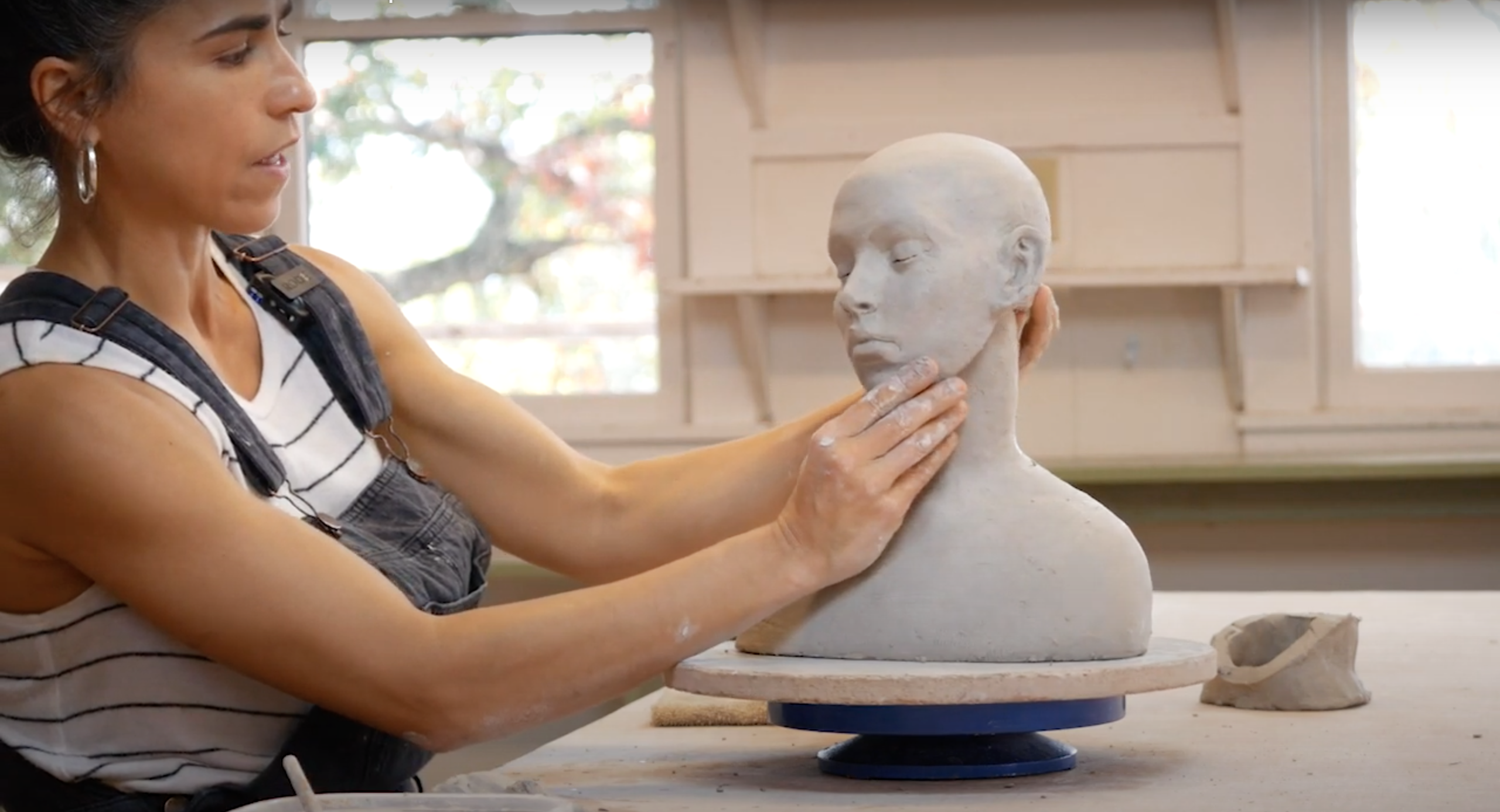 Cristina playing with gesture with her nearly completed head and neck