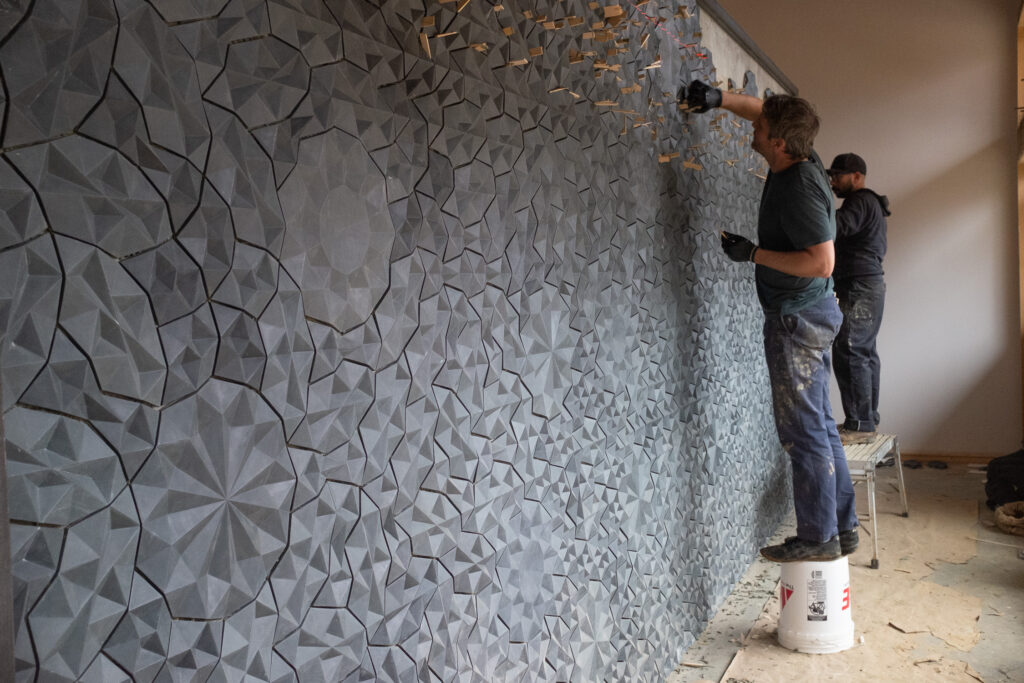 Ian Henderson and Daniel Beck working on tile installation