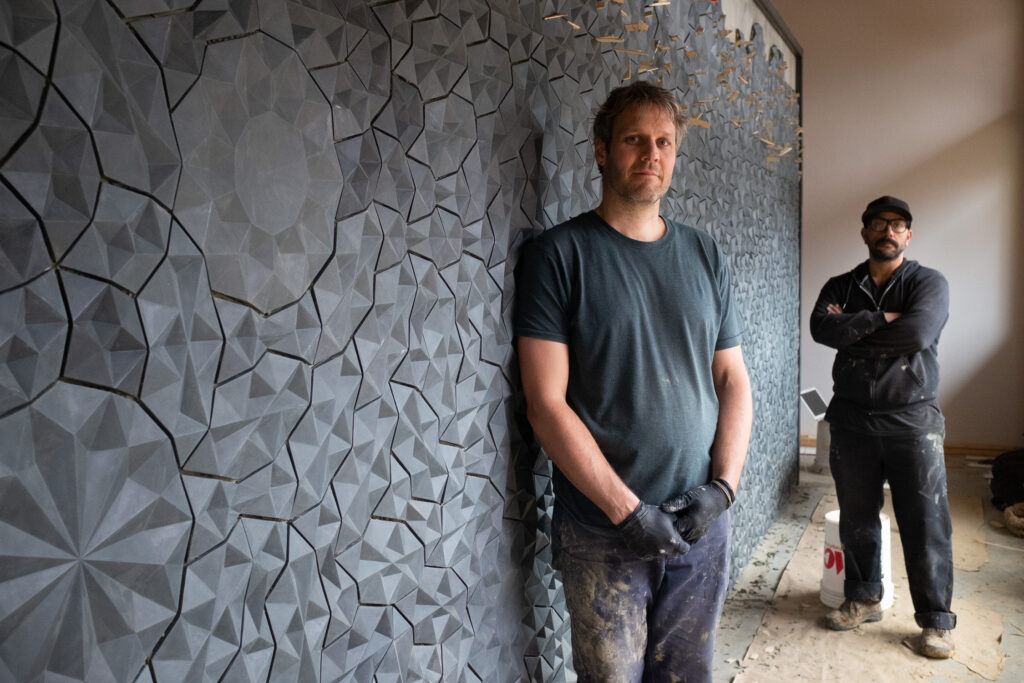Ian Henderson and Daniel Beck with tile installation