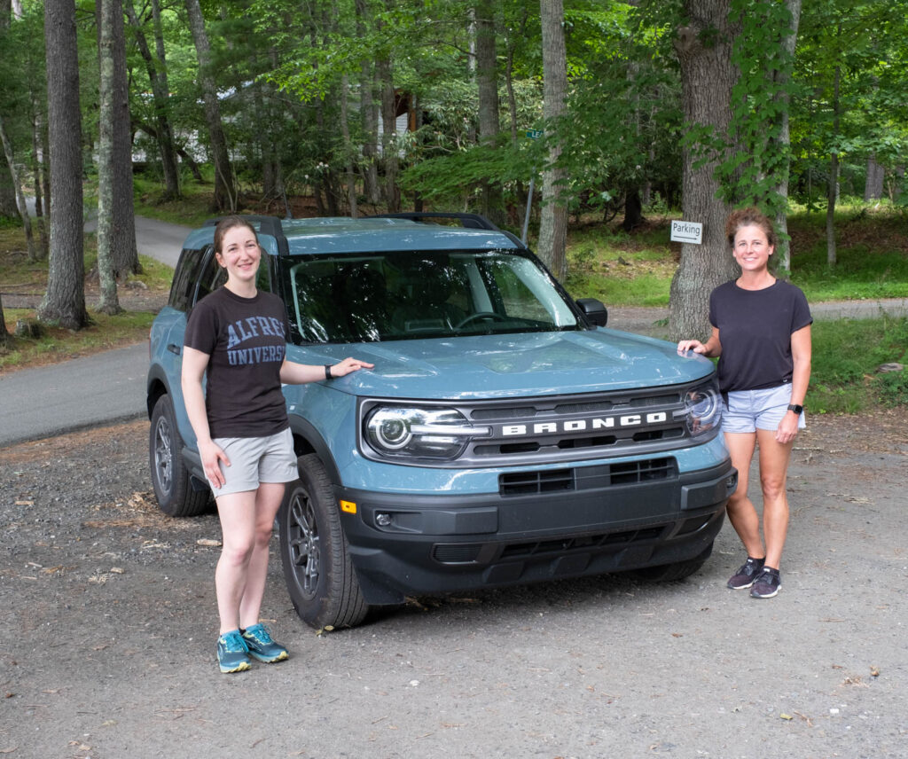 Students Anna Burke and Krisin Grandy with Kristin's Ford Bronco