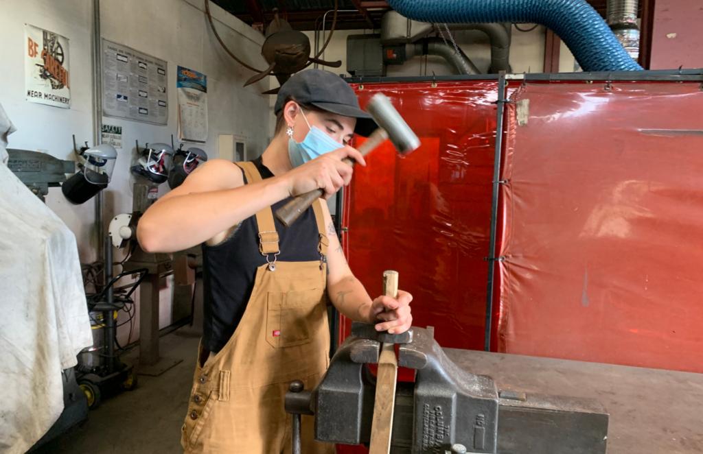 10. Iron studio intern Odette helps fix a tool