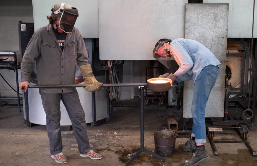 6. Glass studio intern John assists visiting artist Fred Kahl