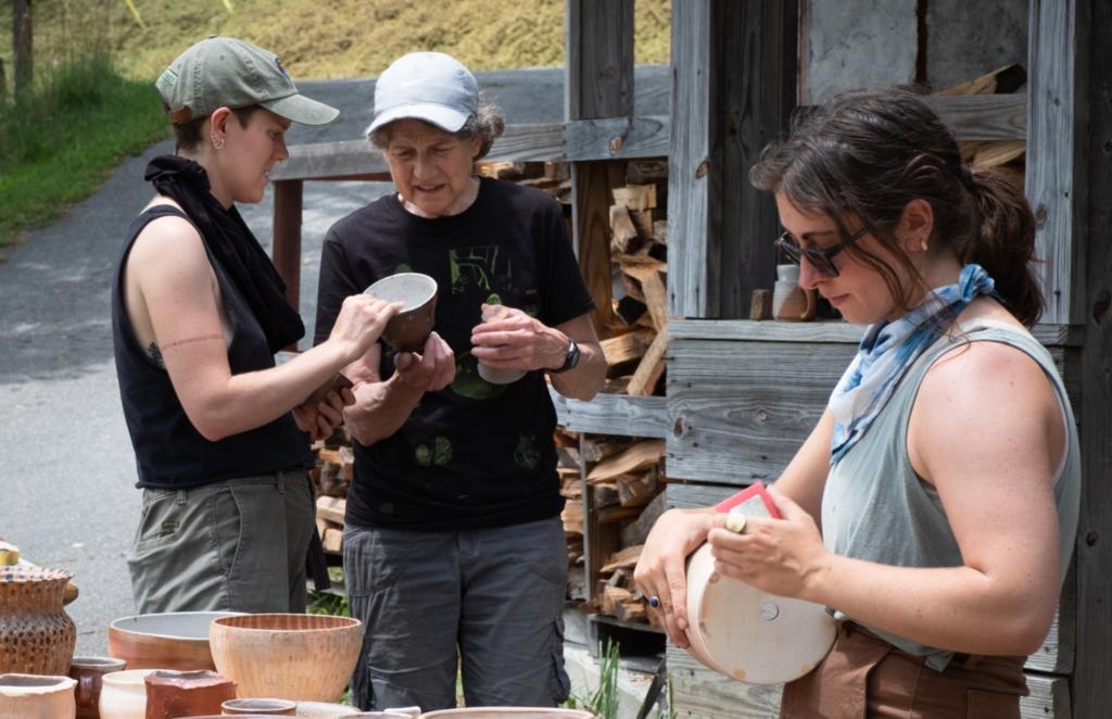 8. Clay intern Nora assists instructor Linda Christianson
