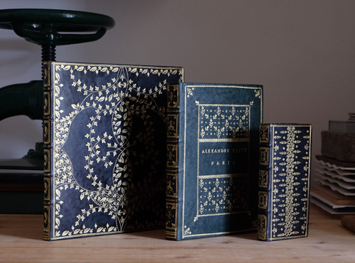 three leather bound books by Brien Beidler