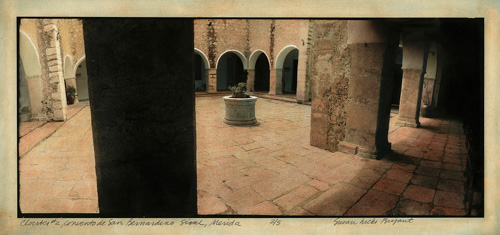 panoramic image of a tiled courtyard surrounded by arches