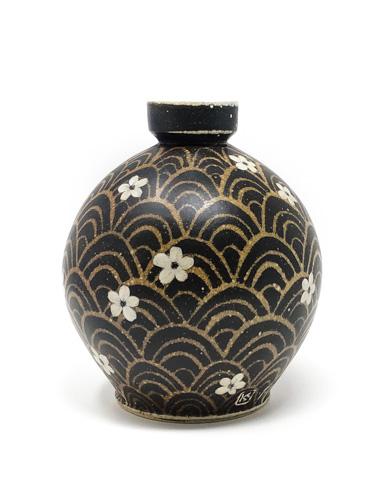 Black ceramic bottle with flower pattern