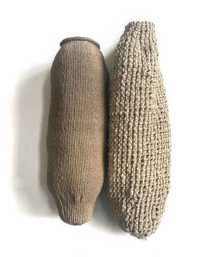 two fiber vessels, one smoother and one with a more knotted texture