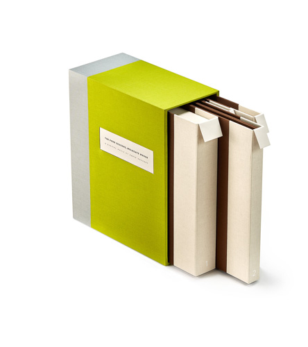 Bright green slipcase with three artists' books inside