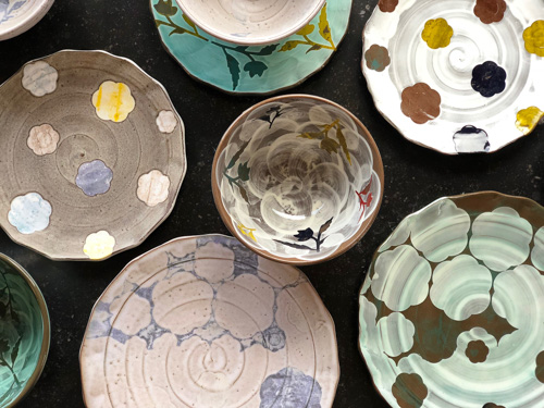 A selection of colorful, patterned plates and bowls by Sanam Emami