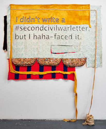 "textile installation that reads ""I didn't write a #secondcivilwarletter, but I haha-faced it."