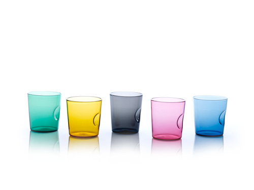 glass cups in green, yellow, black, magenta, and blue