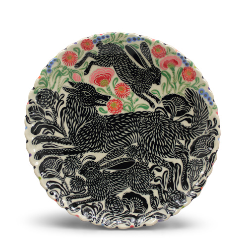 Elaborately illustrated plate with animals and flowers