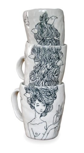 3 stacked ceramic mugs with an image of a woman's hair that carries up the stack