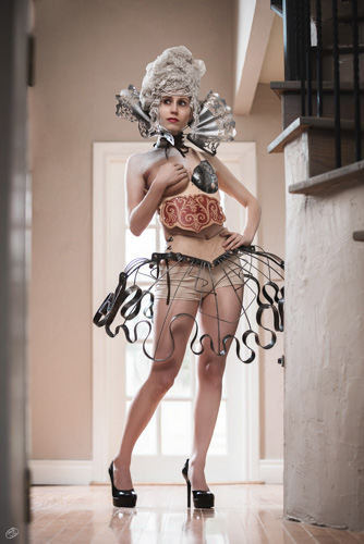 model wearing a a forged metal skirt, chestpiece, and collar