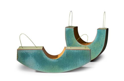Aqua-colored ceramic forms by Lynn Duryea