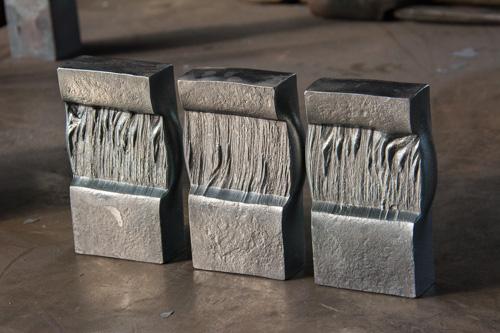 intricately textured steel sculptures