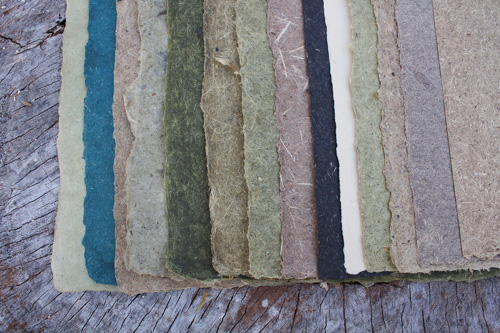 selection of green, brown, purple, and blue handmade papers