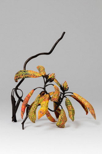 sculpture of orange patterned leaves on a branch