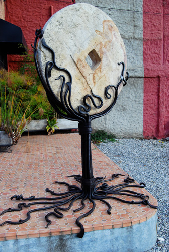 grindstone held up by a sculptural forged stand