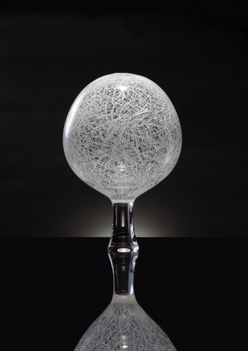 Clear glass orb sculpture webbed with white lines