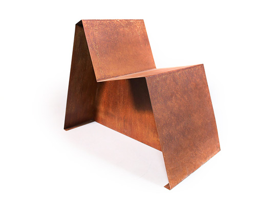 angular chair from rusted sheet metal