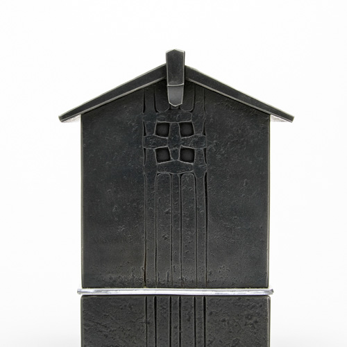 textured metal house sculpture