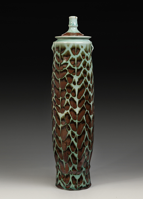 Tall lidded jar in brown and aqua glazed porcelain