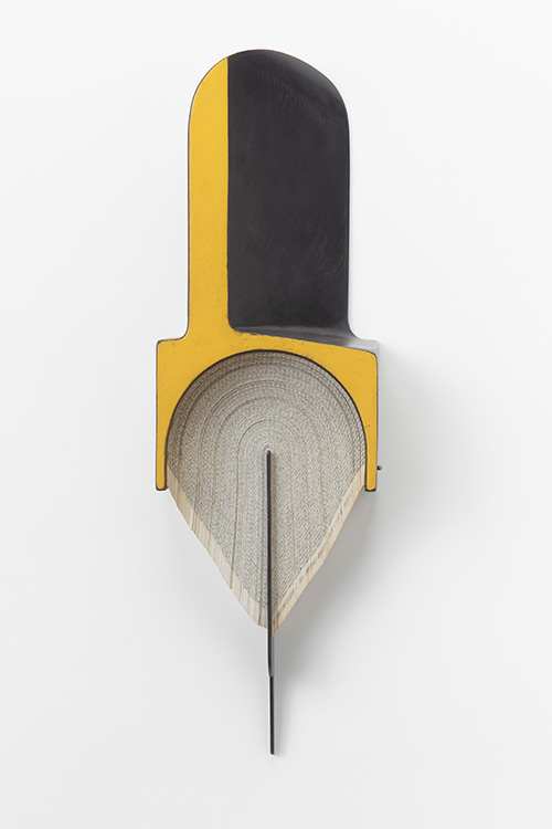 steel wall sculpture by Andrew Hayes with accents of yellow paint and book pages
