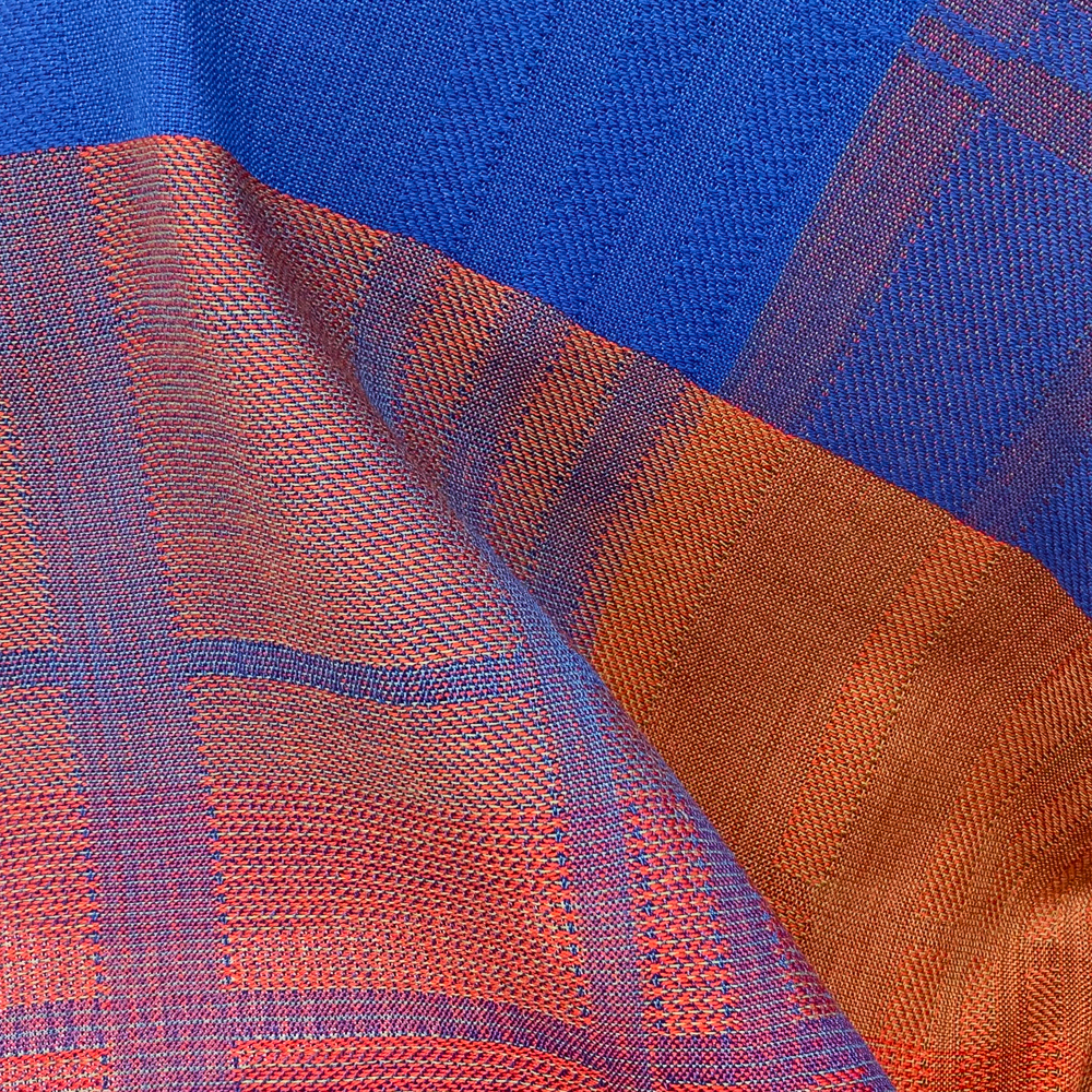 weaving in red, blue, and orange