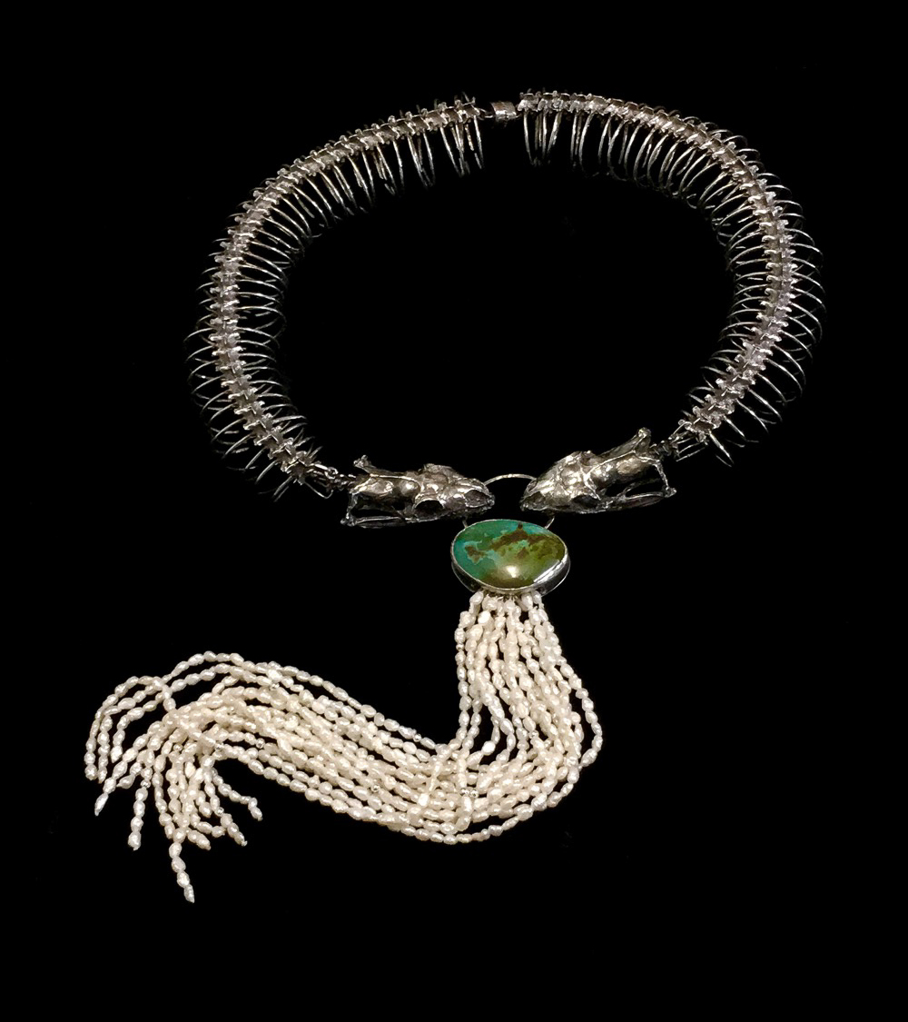 Necklace with green stone and long pearl fringe