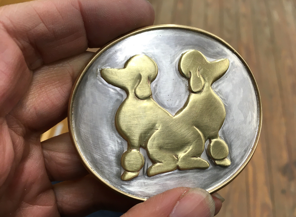 Belt buckle with two poodles