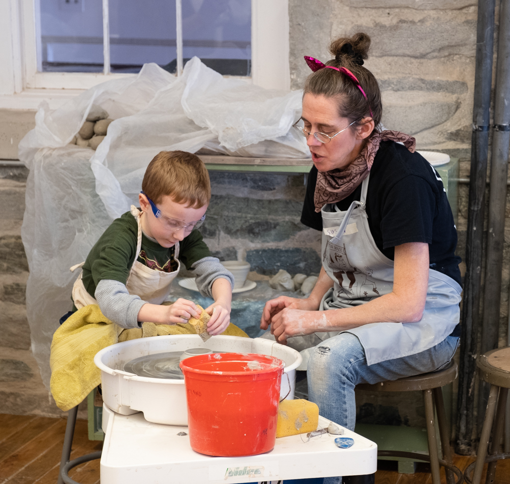 Activity in the Penland clay studio during the annual community open house