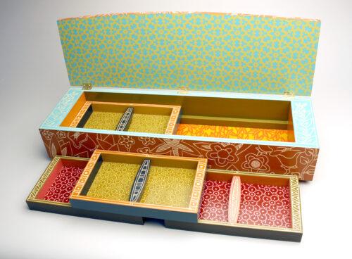 Jenna Goldberg, Orange Jewelry Box, painted and carved basswood, screenprinted interior, 5 x 28 x 8 inches